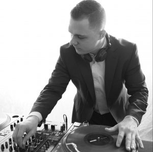 DJ mixing music on equipment - DJ Hire Auckland